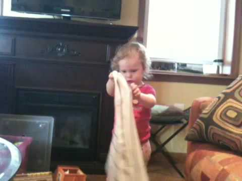 Alice making a hat out of a towel