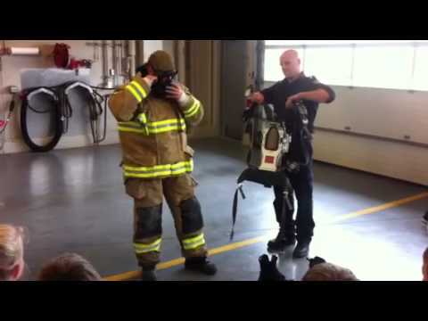 How long does it take for a firefighter to get dressed?