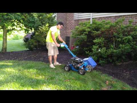 Edging a landscape garden with a Bluebird Bed Bug Landscape Edger New Oxford - Ryan's Landscaping