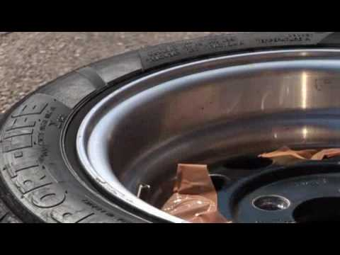 Removing protective coating from aluminium wheels with acid