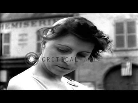 People cut the hair of French women collaborators in the village square of Nemour...HD Stock Footage