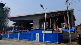 Chinese workers rotate 15,000-ton bridge 81 degrees