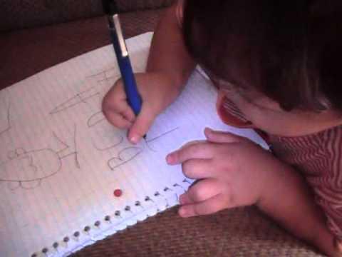 2 year old toddler writing alphabet