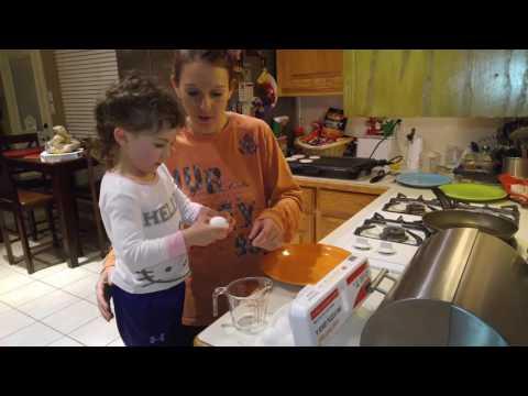 Sydney helping mommy cook December 31st 2015