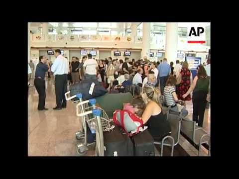 Foreigners gather at airport looking to leave the country