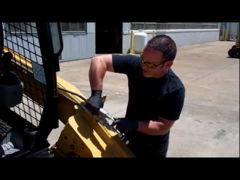 How to Release Auxiliary Hydraulic Pressure on a Cat 256C Skid Steer Loader