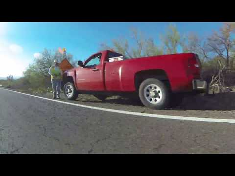 Cactus in Bloom, Truck that Dooms, Road Work Ahead on the AZ-86 Highway to Sells, Arizona GP025983