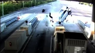 Passenger flung out of vehicle after crashing into toll gate