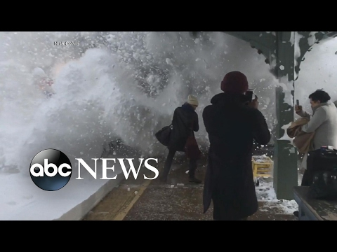 Ultimate snowball fight as train barrels into station