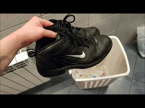 Is this guy nuts? He's throwing his Nike shoes away!