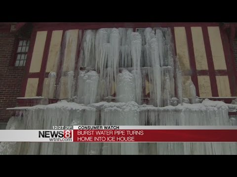 Water from burst pipe freezes down side of Detroit home