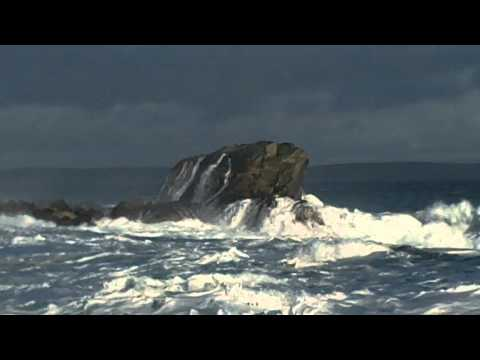 Sea crashing over rocks at Burravoe Yell Shetland