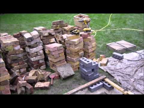 Building a new greenhouse base from salvaged bricks