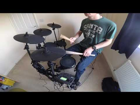Danny learning to play Don't Look Back in Anger on drums