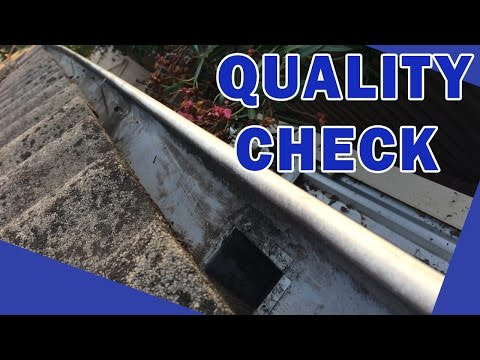 Gutter Cleaning Inspection on a Concrete Tiled Roof