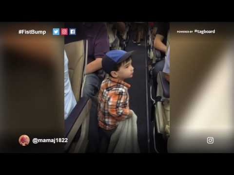 2-year-old gives out fists bumps on the plane