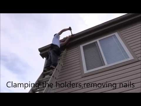DIY. One man  removing and installing a gutter