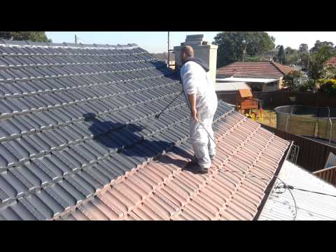 Painting Terracotta Roof Tiles Step 4 applying Dulux Paint - Able Roof Restoration