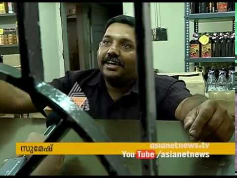 Liquor shops in Kerala start installing token system