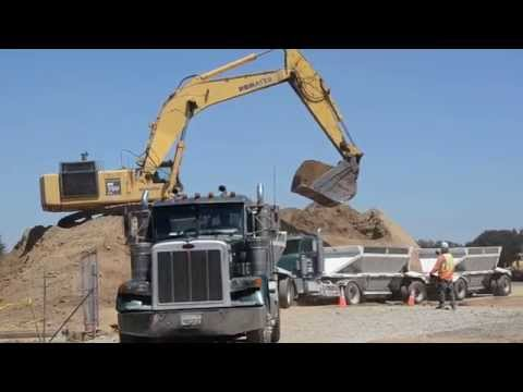 Excavator video: loading trucks on busy construction site (Kids video)