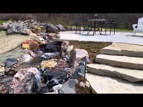 Brand new pond, waterfall, bridge, slab stone patio and steps