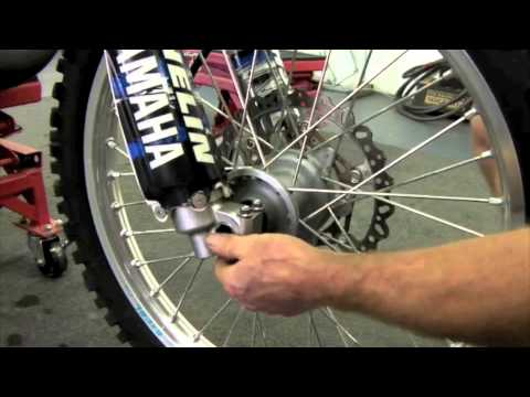 The correct way to tighten your dirtbike's front wheel