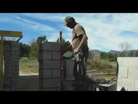 Masons build concrete block column at the Meadow House