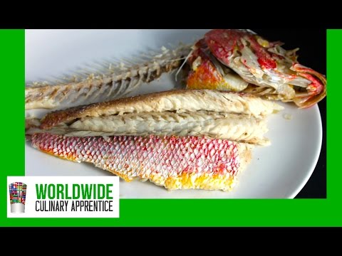 Fillet and Deboned Whole Baked Fish - Removing the bones from a cooked whole fish