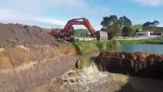 Hitachi Zaxis 350 LCH releasing sandstone dam