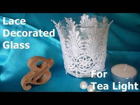 Lace decorate candle holder .