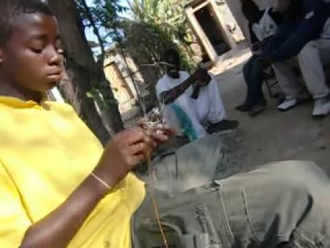 Making beaded wire animals, Chitungwiza Zimbabwe 2010