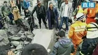 Landslide in China buries hundreds