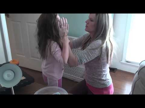 Severe Autism Meltdown. Mother Attempts to Restrain Autistic Daughter from Self-Injury