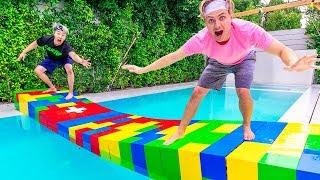 $10,000 LEGO BRIDGE ACROSS POOL!!