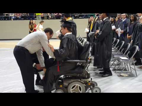 Doug Haynes 19 year old from Bearden, AR with MD walks to receive High School Diploma