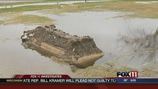 Manitowoc grave erupts due to flooding