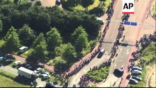 Convoy of hearses leave Eindhoven; aerials; crowds line the streets