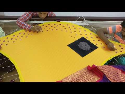 Mirror work on a designer skirt - shisha work