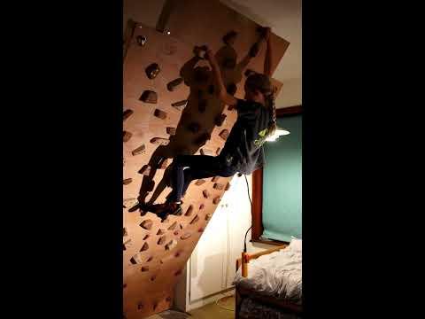 Hinged adjustable home climbing wall