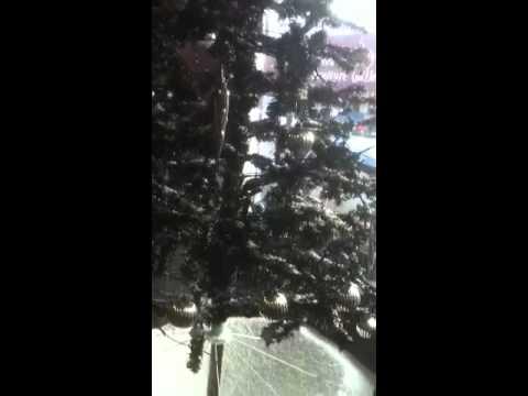Snowing artificial tree