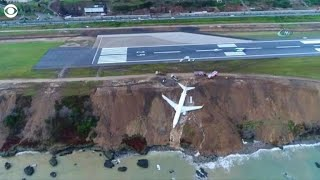 Plane hangs off cliff after skidding off runway in Turkey