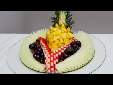 CUT WATERMELON, MELON, GRAPES AND PINEAPPLE AND MAKE A WONDERFUL FRUIT CENTER