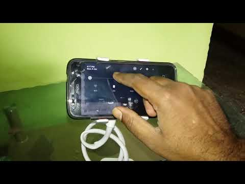 Moto g5s plus used in adjustable mobile stand