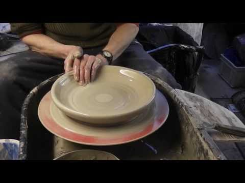 Making , Trimming & Decorating a large pottery plate on the wheel