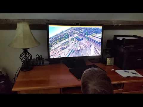 Nicolas flying Google Earth flight simulator