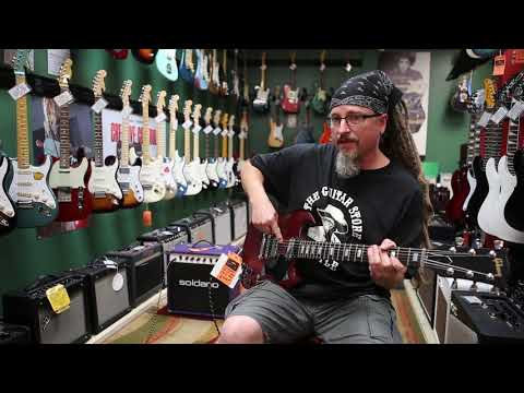 How to play a pick (pinch) harmonic   Teachers' Tips   The Guitar Store