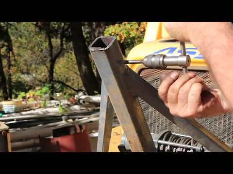 Home built log skidder attachment and modification