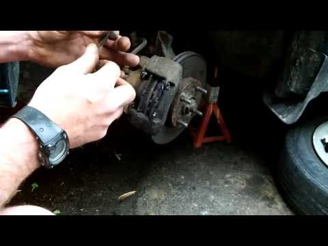 How to change 1998 Ford Escort front brake pads and rotors