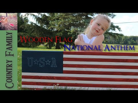 Wooden Flag made from a 2 X 8 with National Anthem by a 4 year old (very cute)