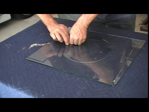 cut a hole in glass for a cat or dog door